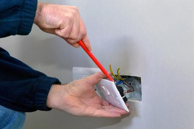 Borehamwood electrician fixing an electric socket